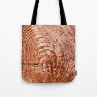 tree rings Tote Bags featuring Tree Rings by rebecca haegele