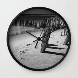 Trail of footprints on the beach at Kirk Park near Grand Haven on Lake Michigan Wall Clock