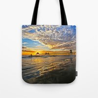 calendars Tote Bags featuring Sunset ~ Huntington Beach Pier CA  11/12/13 by John Minar Fine Art Photography