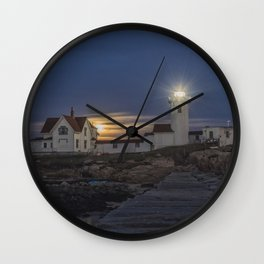 Full moon rising over Eastern point Lighthouse. Wall Clock