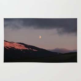 Moon over blackness and red pink ice Rug