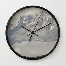 Dwarfed by Mountains Wall Clock