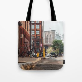 Crossing the divide Tote Bag
