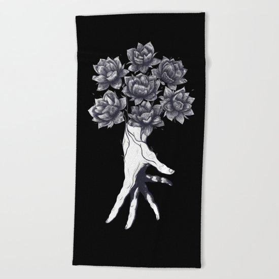 Hand with lotuses on black Beach Towel