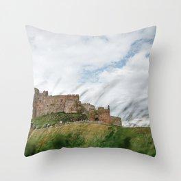 Bamburgh castle through the wild sea grass, Northumberland, England. Throw Pillow