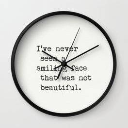 I've never seen a smiling face that was not beautiful. Wall Clock