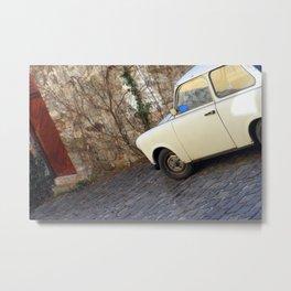 Yellow car on brick road Metal Print