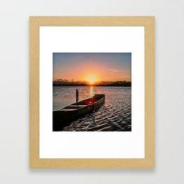 Boat at sunset Framed Art Print