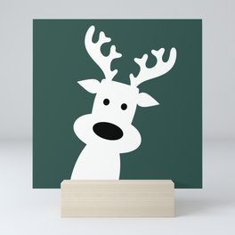 Reindeer on green background Mini Art Print