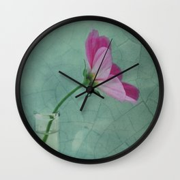 The flower speaks of love silently, in a language known only to the heart Wall Clock