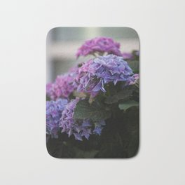 Big Hortensia flowers in front of a window Bath Mat