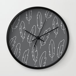 White painted feathers on a gray background. Wall Clock