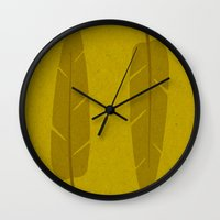 banana leaf Wall Clocks featuring Banana Leaf Yellow by Endless Summer