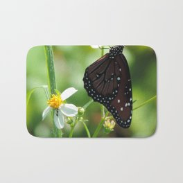 The monarch and the ant Bath Mat