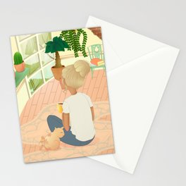 girl with cat relaxing at home looking out the window Stationery Cards
