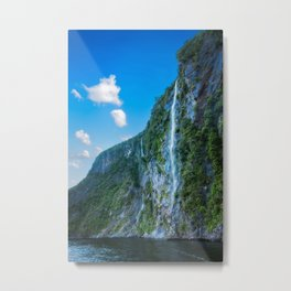 One of the numerous waterfalls falling down the sheer cliffs at Milford Sound. Metal Print