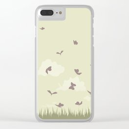 flying butterflies on a green landscape with sun Clear iPhone Case