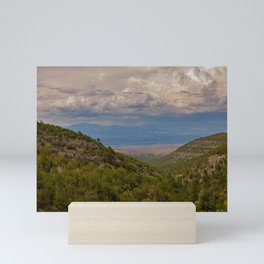 View from the Sandia Man Cave looking towards Placitas, outside of Albuquerque, New Mexico showing the green forest in the Sandia Mountains Mini Art Print
