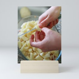 Dicing potatoes Mini Art Print