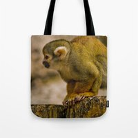 monkey island Tote Bags featuring Little Monkey by Glory Baby Photography