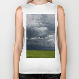 Supercell storm clouds above meadow with green grass Summer Storm clouds Biker Tank