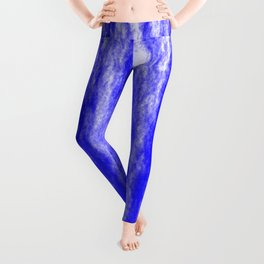 Bright texture of coated paper from blue flowing waves on a dark fabric. Leggings