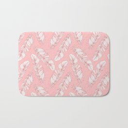 White feathers on a pink background Bath Mat