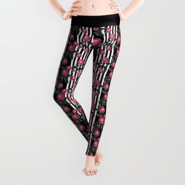 Red roses on black and white striped background. Leggings