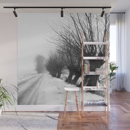 Willows along a snowy road. Wall Mural