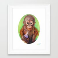 budi satria kwan Framed Art Prints featuring Budi the Rescued Baby Orangutan by Alina Bachmann