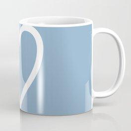Heart sign on placid blue background Coffee Mug