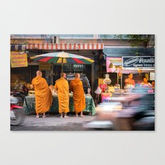 Three Buddhist Monks at the Market Canvas Print