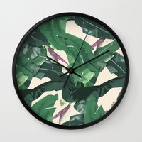 banana leaf Wall Clocks featuring Banana Leaf Pattern by Tamsin Lucie