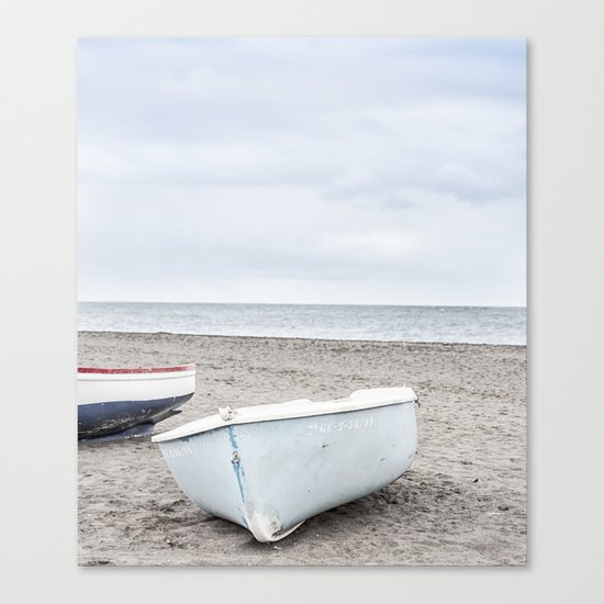 Lonely boats at the beach Canvas Print