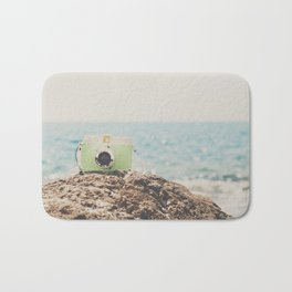 """the """"dreamer"""", a mint green camera with the ocean behind it Bath Mat"""