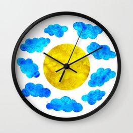 Cute blue cartoon clouds and sun. Wall Clock