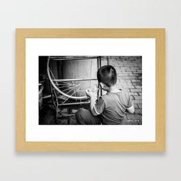 Kid playing in the street Framed Art Print