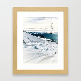 Snowy life on slope under T-bar lifts Framed Art Print