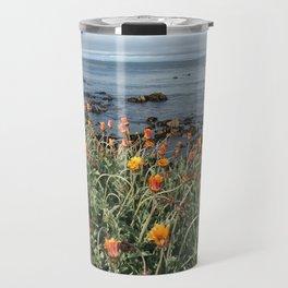Orange blooms along the Pacific Travel Mug