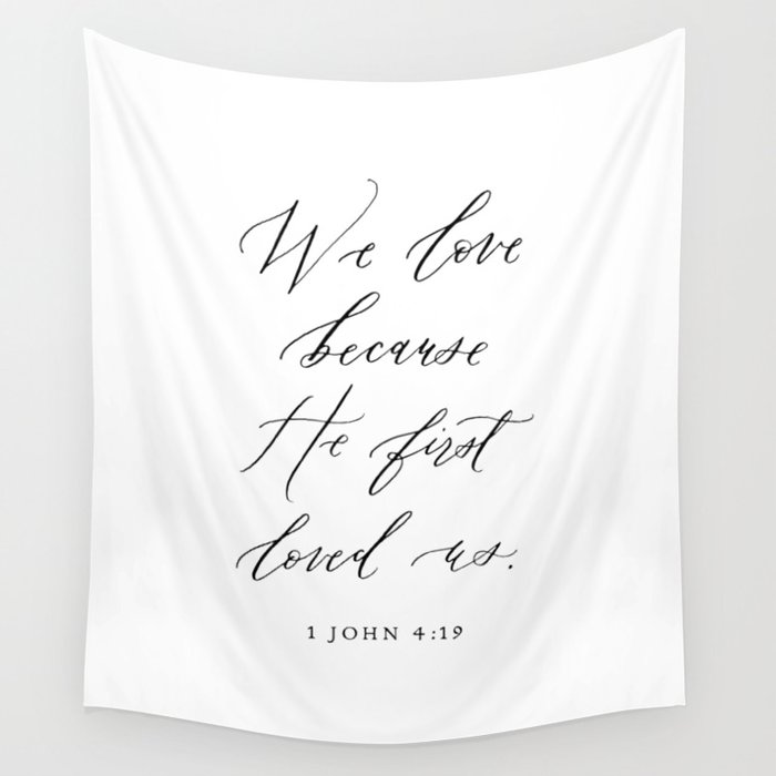 1 John 4:19 We love because He first loved us Wall Tapestry
