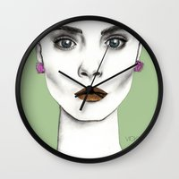 cara Wall Clocks featuring Cara by Vicky Ink.