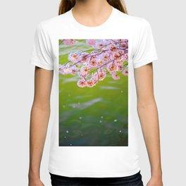 Beautiful Japanese Pink Cherry Blossom Over A colorful Green Garden Pond Petals Drifting Away T-shirt