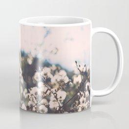 Faded white flowers on the side of a mountain Coffee Mug
