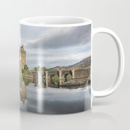 Eilean Donan castle with reflection in the water in Scotland Coffee Mug