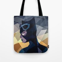 dc comics Tote Bags featuring DC Comics Catwoman by Eric Dufresne