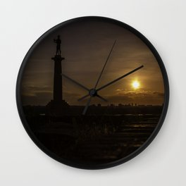 Victor at the end of the day Wall Clock