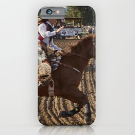A contestant puts her ride through its paces at the Cattlemens Days rodeo in Gunnison Colorado iPhone Case