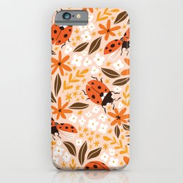 Cute insect hand drawn illustration pattern. Ladybugs and flowers on the pink background. Summer ditzy floral pattern. iPhone Case