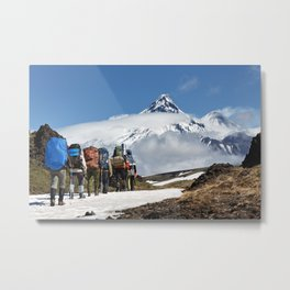 Group of hikers climbing on mountain on background volcanoes of Kamchatka Peninsula Metal Print