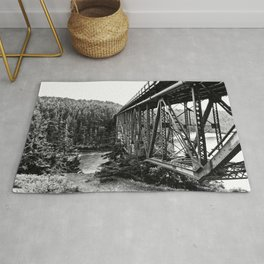 A Bridge into the Woods Rug